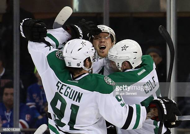 Ales Hemsky of the Dallas Stars celebrates his game winning goal in overtime against the New York Rangers with Tyler Seguin and Erik Cole at Madison...