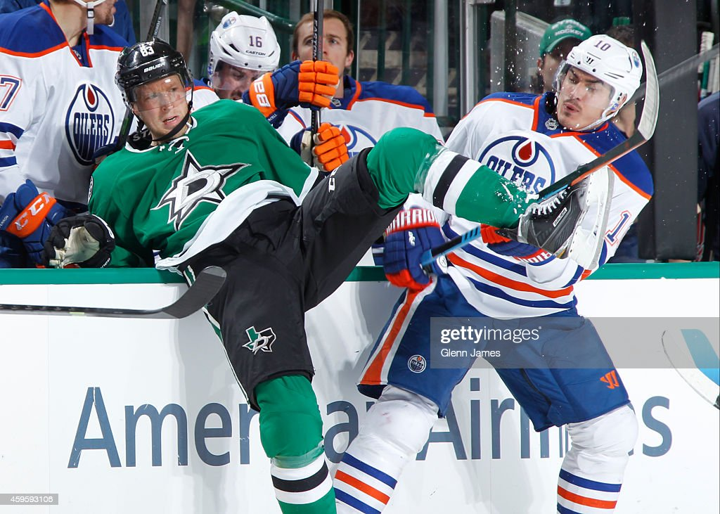 Ales Hemsky #83 of the Dallas Stars has a collision against Nail Yakupov #10 of the Edmonton Oilers at the American Airlines Center on November 25, 2014 in Dallas, Texas.