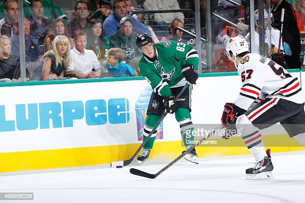 Ales Hemsky of the Dallas Stars looks to pass to a teammate against Trevor Van Riemsdyk of the Chicago Blackhawks at the American Airlines Center on...