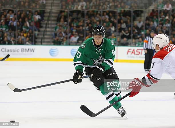 Ales Hemsky of the Dallas Stars skates the puck against Andrej Sekera of the Carolina Hurricanes in the first period at American Airlines Center on...