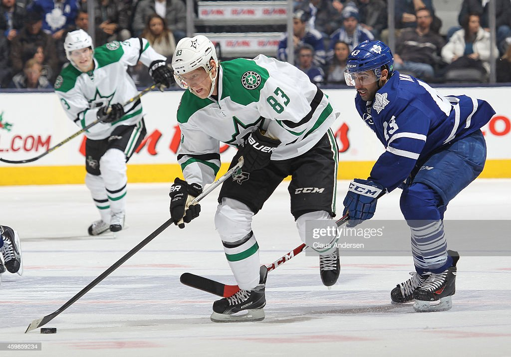 Ales Hemsky #83 of the Dallas Stars skates with the puck checked by Nazem Kadri #43 of the Toronto Maple Leafs during an NHL game at the Air Canada Centre on December 2, 2014 in Toronto, Ontario, Canada. The Leafs defeated the Stars 5-3.