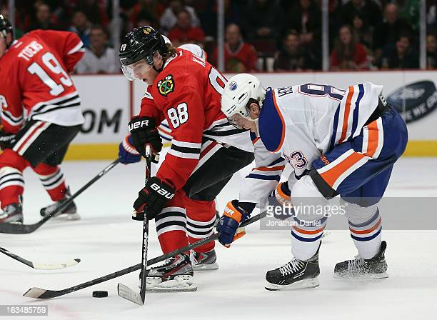 Ales Hemsky of the Edmonton Oilers knocks the puck away from Patrick Kane of the Chicago Blackhawks at the United Center on March 10 2013 in Chicago...