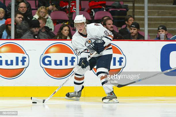 Ales Hemsky of the Edmonton Oilers skates with the puck during the game against the New Jersey Devils on December 13 2005 at the Continental Airlines...