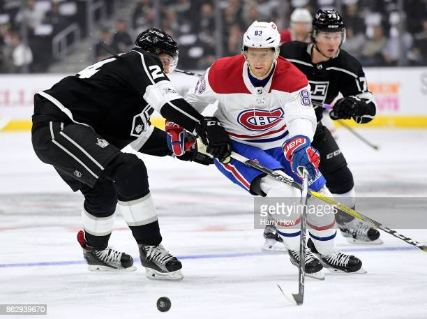 Ales Hemsky of the Montreal Canadiens attempts to poke the puck around Derek Forbort of the Los Angeles Kings during the first period at Staples...