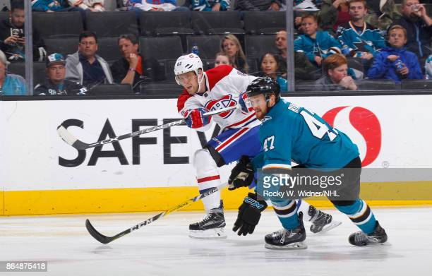 Ales Hemsky of the Montreal Canadiens passes the puck against Joakim Ryan of the San Jose Sharks at SAP Center on October 17 2017 in San Jose...