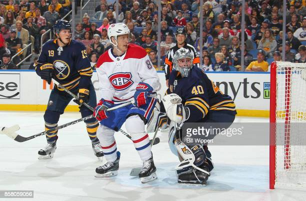Ales Hemsky of the Montreal Canadiens watches a shot go wide while defended by Robin Lehner and Jake McCabe of the Buffalo Sabres during an NHL game...