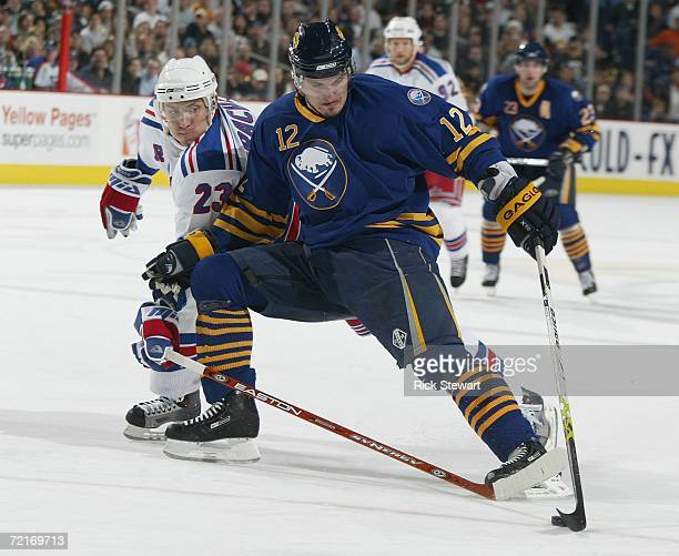 Ales Kotalik of the Buffalo Sabres pushes toward the net as Karel Rachunek of the New York Rangers defends on October 14, 2006 at HSBC Arena in...