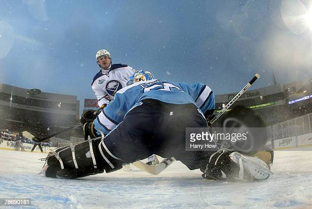 Ales Kotalik of the Buffalo Sabres scores on goaltender Ty Conklin of the Pittsburgh Penguins in the shoot out of the NHL Winter Classic at the Ralph...