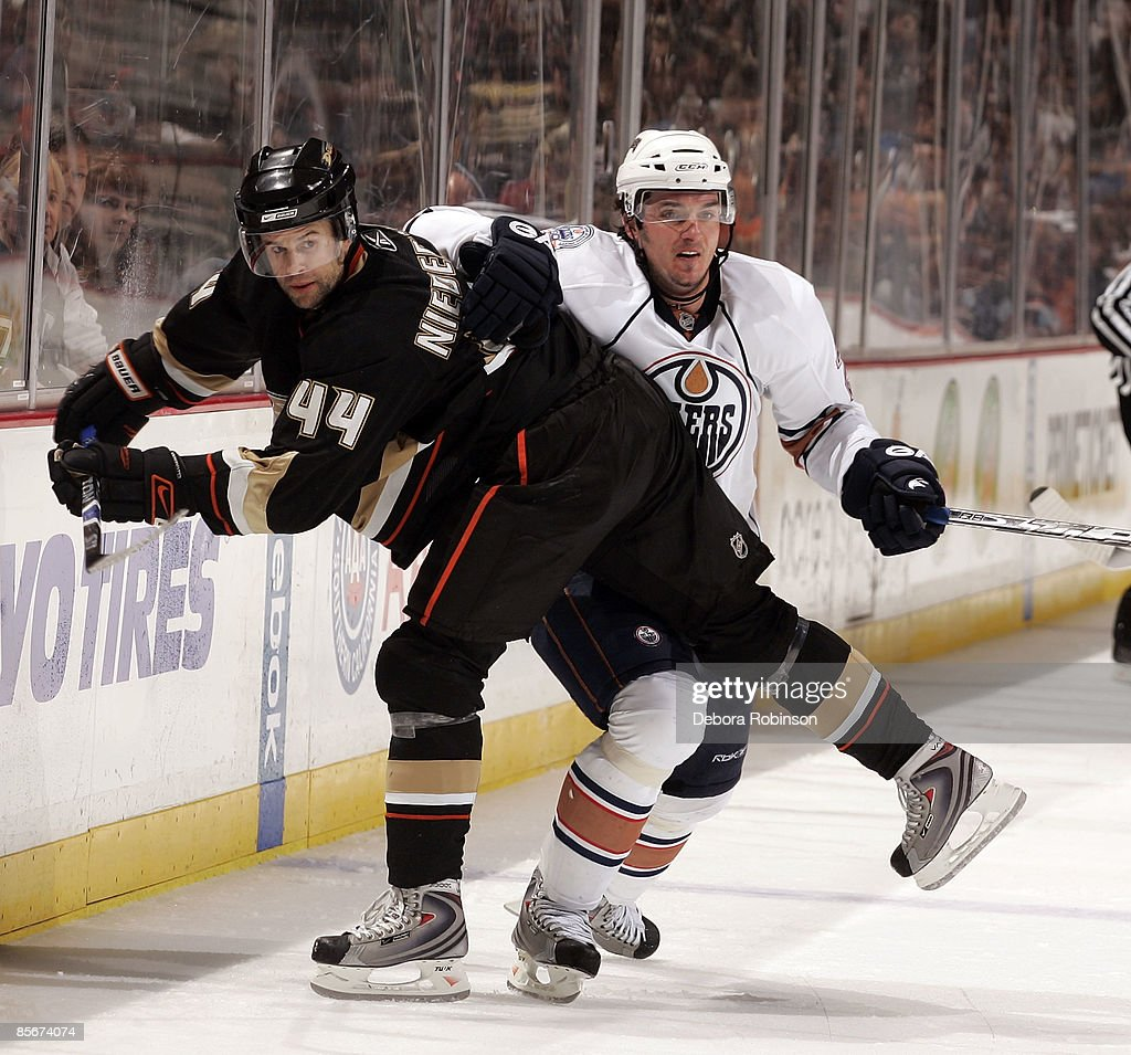 Ales Kotalik #21 of the Edmonton Oilers defends against Rob Niedermayer #44 of the Anaheim Ducks during the game on March 27, 2009 at Honda Center in Anaheim, California.