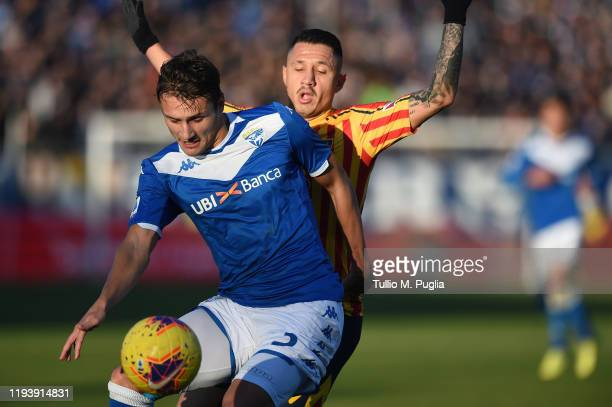 Ales Mateju of Brescia and Gianluca Lapadula of Lecce compete for the ball during the Serie A match between Brescia Calcio and US Lecce at Stadio...