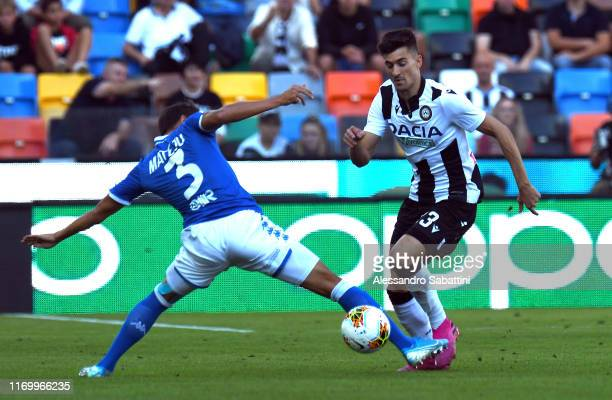 Ales Mateju of Brescia Calcio competes for the ball with Ignacio Pussetto of Udinese Calcio during the Serie A match between Udinese Calcio and...