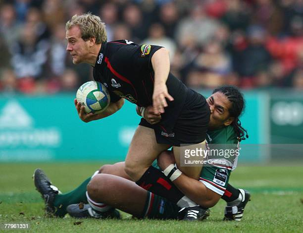Alesana Tuilagi of Leicester battles with Andrew Turnbull of Edinburgh during the Heineken Cup Round Two match between Leicester Tigers and Edinburgh...