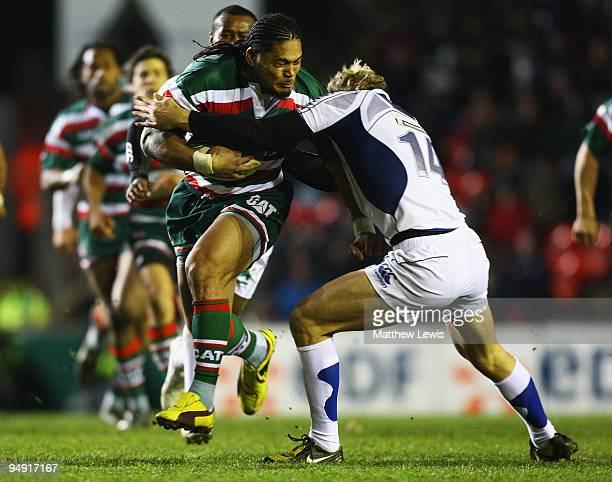 Alesana Tuilagi of Leicester is tackled by Aurelien Rougerie of ASM Clermont Auvergne during the Heineken Cup match between Leicester Tigers and ASM...
