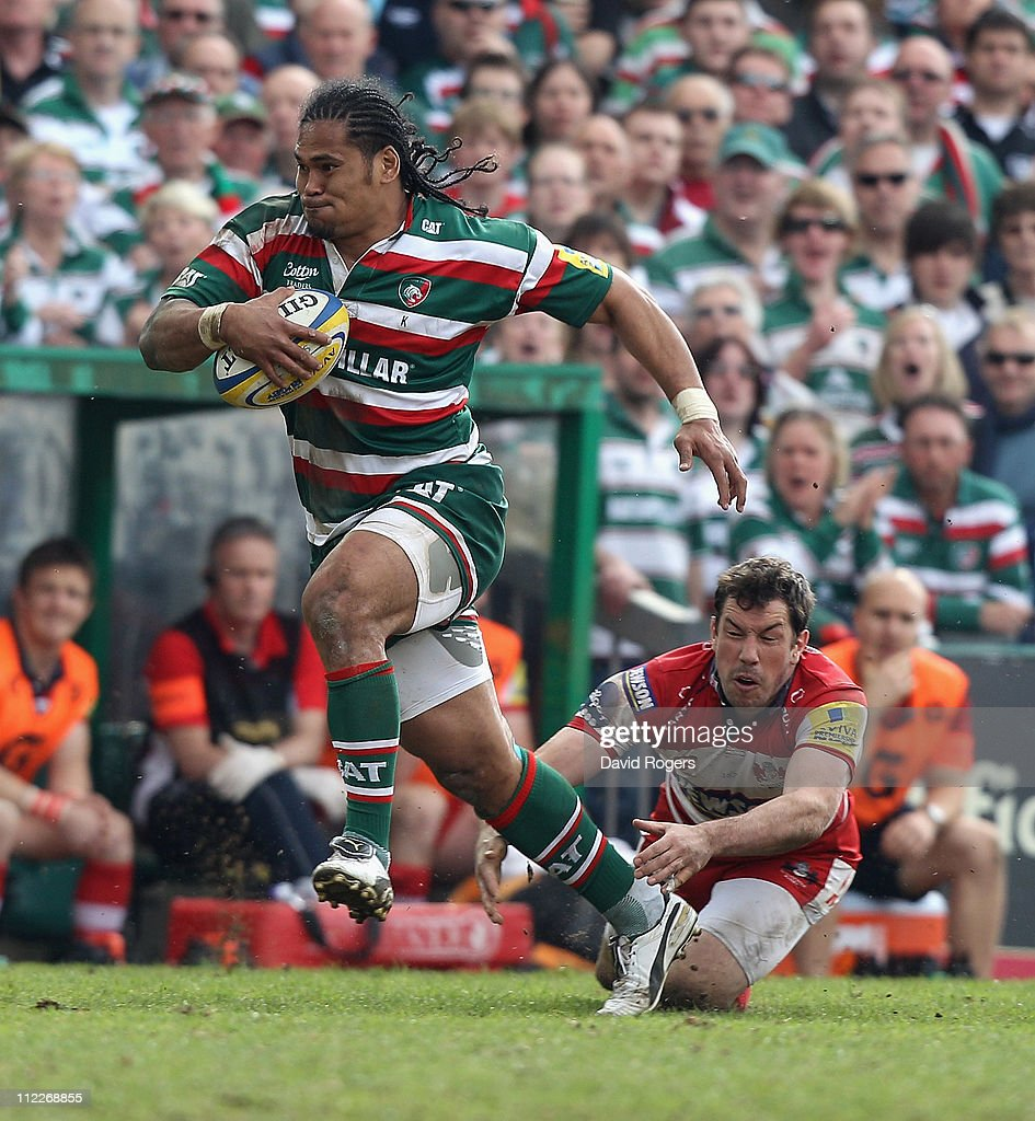 Alesana Tuilagi of Leicester races clear of Tom Voyce to score his second try during the Aviva Premiership match between Leicester Tigers and Gloucester at Welford Road on April 16, 2011 in Leicester, England.