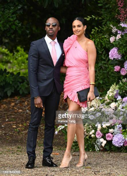 Alesha Dixon and Azuka Ononye seen arriving at the wedding of Ant McPartlin and Anne-Marie Corbett at St Michael's Church in Heckfield on August 07,...