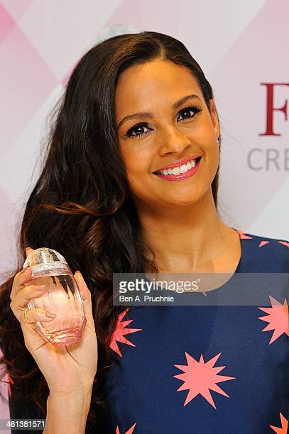 Alesha Dixon attends a photocall to launch her new fragrance 'Rose Quartz' at St Martin's Lane Hotel on January 8 2014 in London England