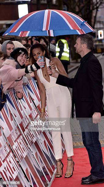 Alesha Dixon is sheilded from the rain by a Union Jack umberella as she takes a selfie with a fan as she attends the Britain's Got Talent auditions...