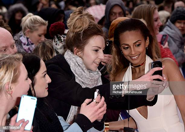Alesha Dixon takes a selfie with fans as she attends the Britain's Got Talent auditions at Birmingham Hippodrome on February 5 2015 in Birmingham...