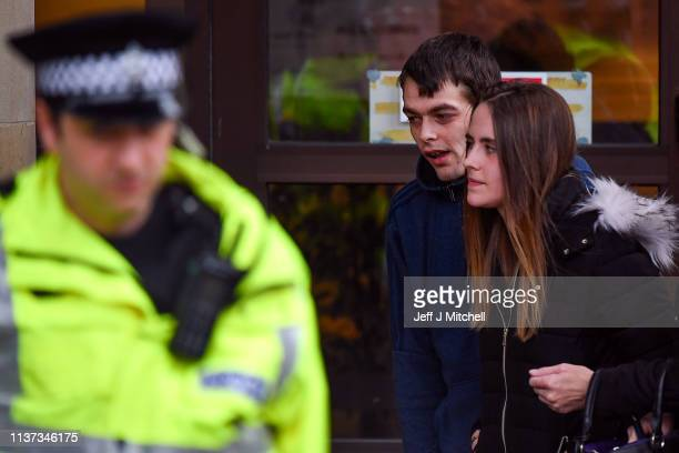 Alesha MacPhail's father Robert MacPhail and his girlfriend Toni Louise McLachlan appear outside Glasgow High Court on March 21 2019 in Glasgow...