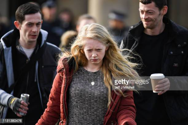 Alesha MacPhail's mother Georgina Lochrane leaves Glasgow High Court following the judge lifting the ban on the murderers anonymity on February 22...
