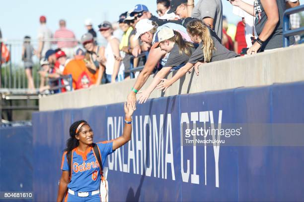 Aleshia Ocasio of the University of Florida high fives fans during Game 2 of the Division I Women's Softball Championship held at ASA Hall of Fame...