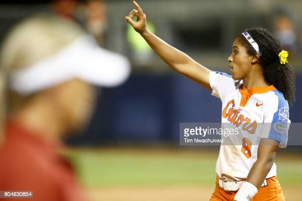 Aleshia Ocasio of the University of Florida signals to outfielders during the Division I Women's Softball Championship held at ASA Hall of Fame...