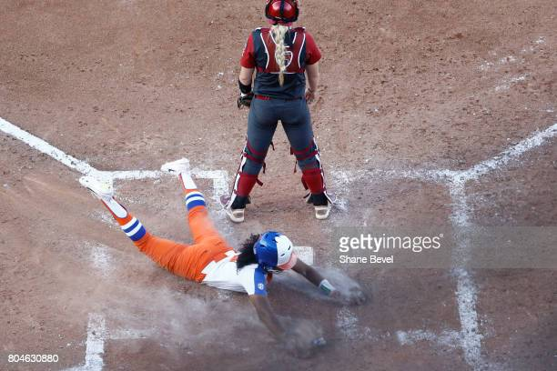 Aleshia Ocasio of the University of Florida slides into home plate during the Division I Women's Softball Championship held at ASA Hall of Fame...