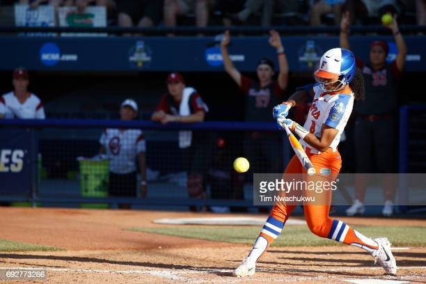Aleshia Ocasio of the University of Florida swings at a pitch against the University of Oklahoma during Game 1 of the Division I Women's Softball...