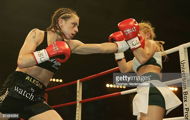 Alesia Graf hits Beatrix Farago during the Juniors Bantam weight fight between Alesia Graf of Belarus and Beatrix Farago of Hungary at the Hanns...
