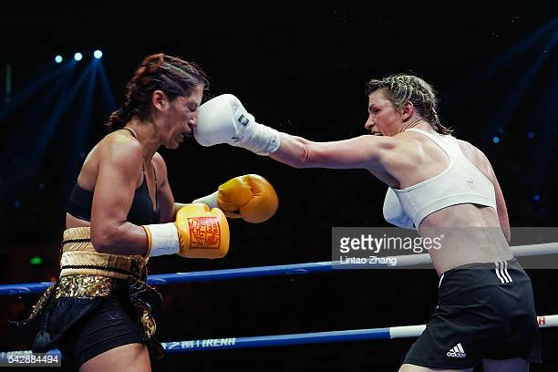 Alesia Graf of Germany delivers a punch to Noemi Bosques of United States during their International Women's WBA featherweight gold belt match at...