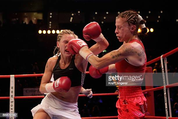 Alesia Graf of Germany takes a punch on Terri Lynn Cruz of USA during the WIBF Bantamweight World Championship fight between Alesia Graf of Germany...