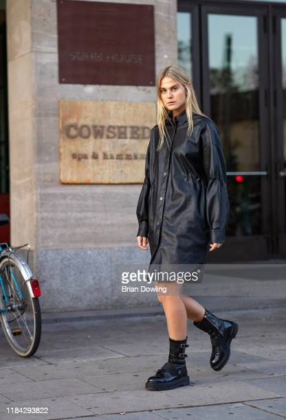 Alessa Winter is seen wearing an oversized black faux leather dress by Lala Berlin and Premiata black leather boots on October 29, 2019 in Berlin,...