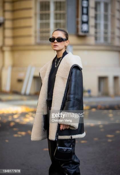 Alessa Winter is seen wearing black boots Miu Miu, Lala Berlin leather pants, Edited jumper, Totem shearling jacket, Prada bag and sunglasses on...