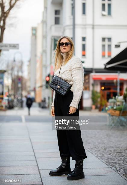 Alessa Winter is seen wearing sunglasses Valentino turtleneck Zara black cropped pants Weekday Chanel bag Premiata boots on December 09 2019 in...