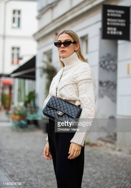 Alessa Winter is seen wearing sunglasses Valentino, turtleneck Zara, black cropped pants Weekday, Chanel bag on December 09, 2019 in Berlin, Germany.