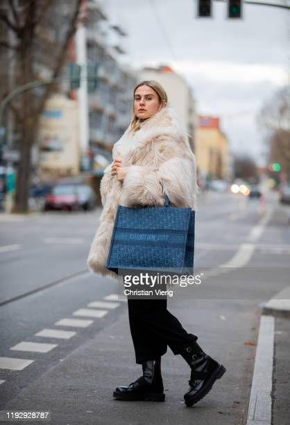 Alessa Winter is seen wearing white fluffy coat &Other Stories, black Weekday pants, boots Premiata, Dior bag on December 09, 2019 in Berlin, Germany.