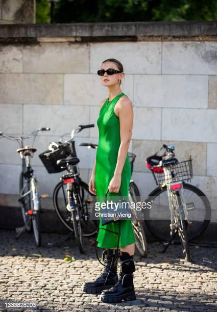 Alessa Winter seen wearing green dress, Balenciaga bag, Prada boots outside Baum und Pferdgarten on August 11, 2021 in Copenhagen, Denmark.