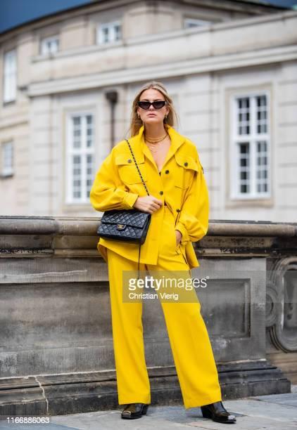 Alessa Winter seen wearing yellow pants, button shirt, Chanel bag outside Lala Berlin during Copenhagen Fashion Week Spring/Summer 2020 on August 08,...