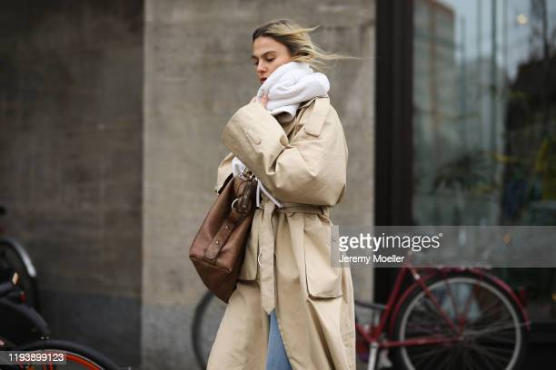 Alessa Winter wearing Adidas Ozweego sneaker, Levis jeans, &otherstories coat, twenty Montreal sweater and vintage Gucci bag on December 12, 2019 in...
