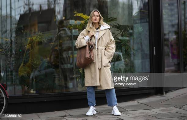 Alessa Winter wearing Adidas Ozweego sneaker Levis jeans otherstories coat twenty Montreal sweater and vintage Gucci bag on December 12 2019 in...