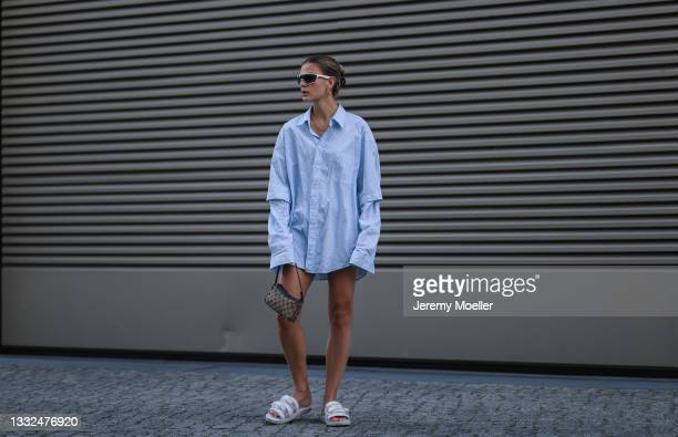 Alessa Winter wearing Balenciaga oversized blue stripe flanell, Prada white shades, Gucci mini vintage bag and Suicoke white sandals on August 03,...