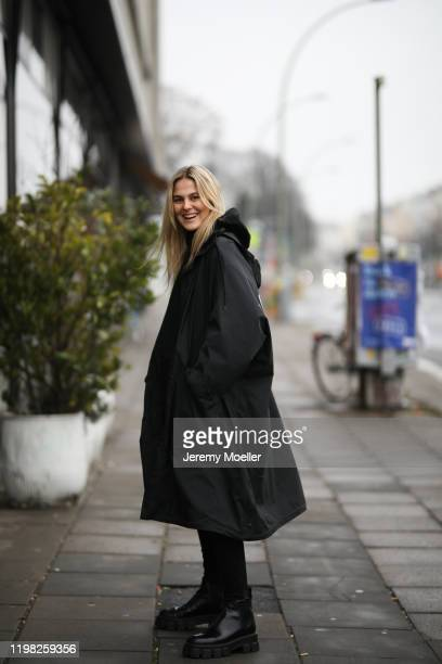 Alessa Winter wearing Balenciaga sweater and raincoat, Prada boots and Levis jeans on January 07, 2020 in Berlin, Germany.