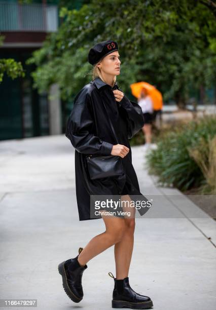 Alessa Winter wearing beret, black leather coat, Celine bag, Dr. Martens boots outside Brøgger during Copenhagen Fashion Week Spring/Summer 2020 on...