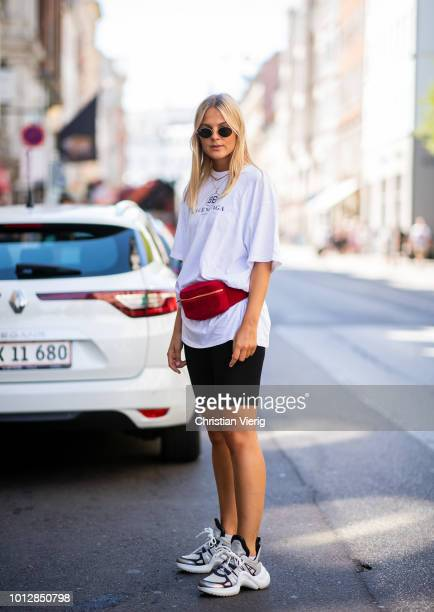 Alessa Winter wearing bike pants, white Balenciaga tshirt, red vevelt belt bag is seen outside Mykke Hofmann during the Copenhagen Fashion Week...