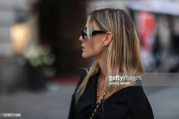 Alessa Winter wearing black Prada shades and black shirt on July 12, 2021 in Berlin, Germany.
