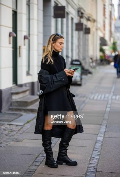 Alessa Winter wearing black turtleneck, Balenciaga coat, boots Copenhagen Studios seen on August 12, 2021 in Copenhagen, Denmark.