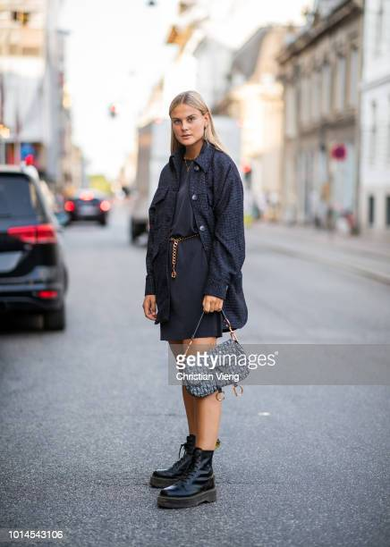 Alessa Winter wearing grey Dior Saddle bag, Dr Martens boots, dark grey jacket and dress seen outside Baum und Pferdgarten during the Copenhagen...