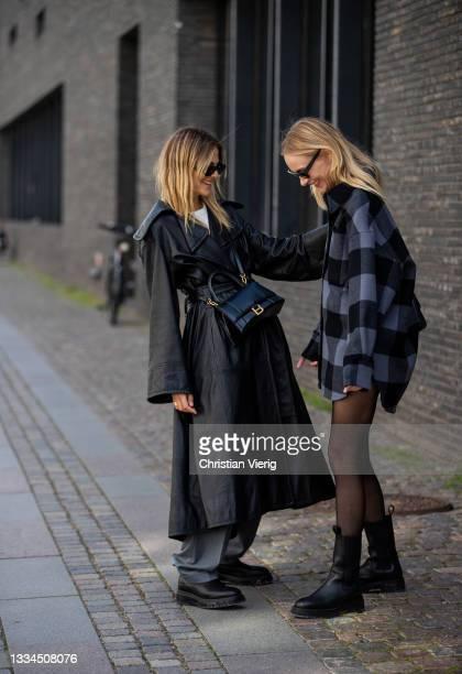 Alessa Winter wearing grey pants, black coat, Balenciaga bag, Copenhagen Studios bootMarie Hindkaer is seen wearing checkered button shirt, sheer...
