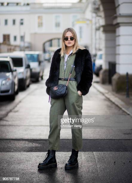 Alessa Winter wearing olive overall Dr Martens boots Gucci bag is seen outside Der Berliner Modesalon during the Berlin Fashion Week January 2018 on...