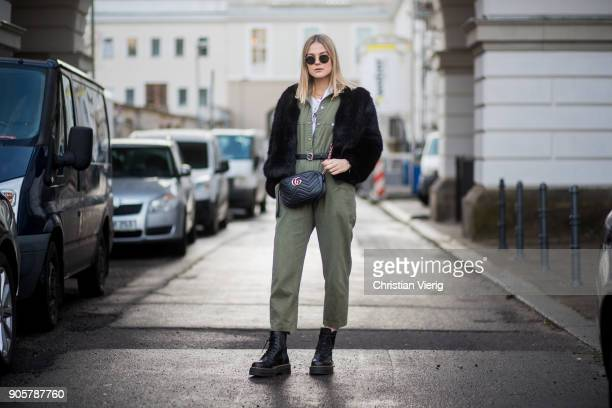 Alessa Winter wearing olive overall, Dr. Martens boots, Gucci bag is seen outside Der Berliner Modesalon during the Berlin Fashion Week January 2018...